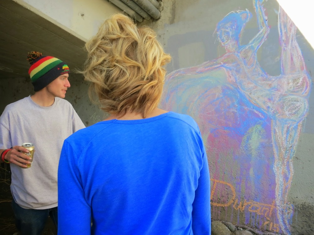 Lynette Eddy was shown some art, under a bridge by the Truckee river, by a young man who lives on the streets.