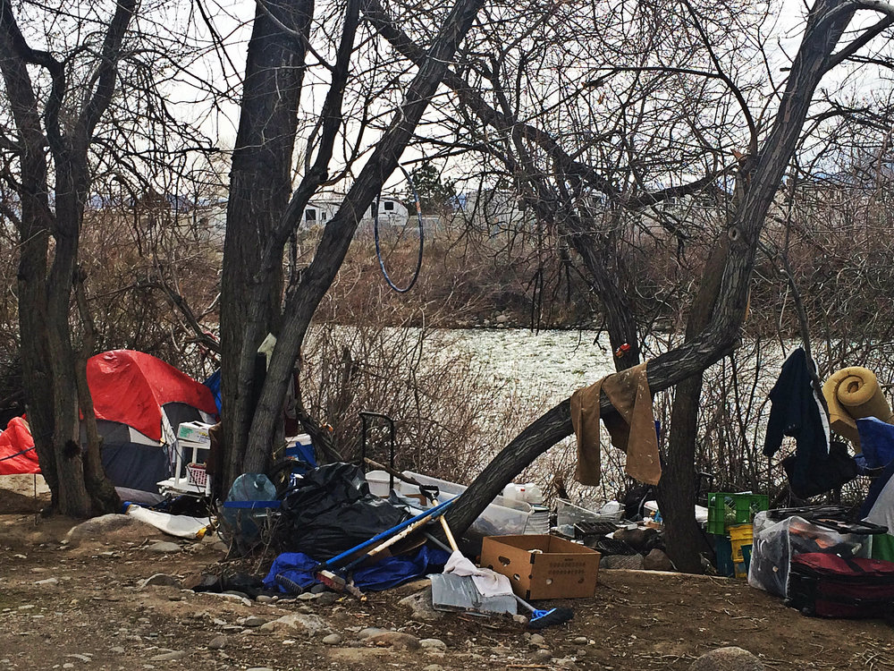 Belongings and tents may soon be removed, but where will the people now living here go? Photo by Monica Gomez