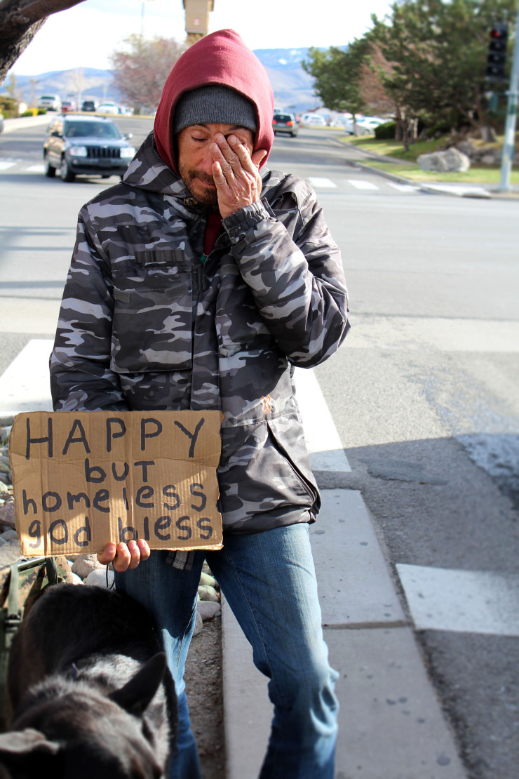 Matt, a homeless man, stands near a shopping center in Reno, trying to get money to afford another night in his motel. Before wiping his eyes, he mentions that he has allergies, and this time of year is hard for him to be on the streets.