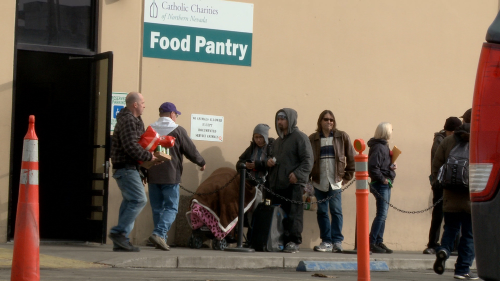 Albert and his family were next in line to get into the food pantry.