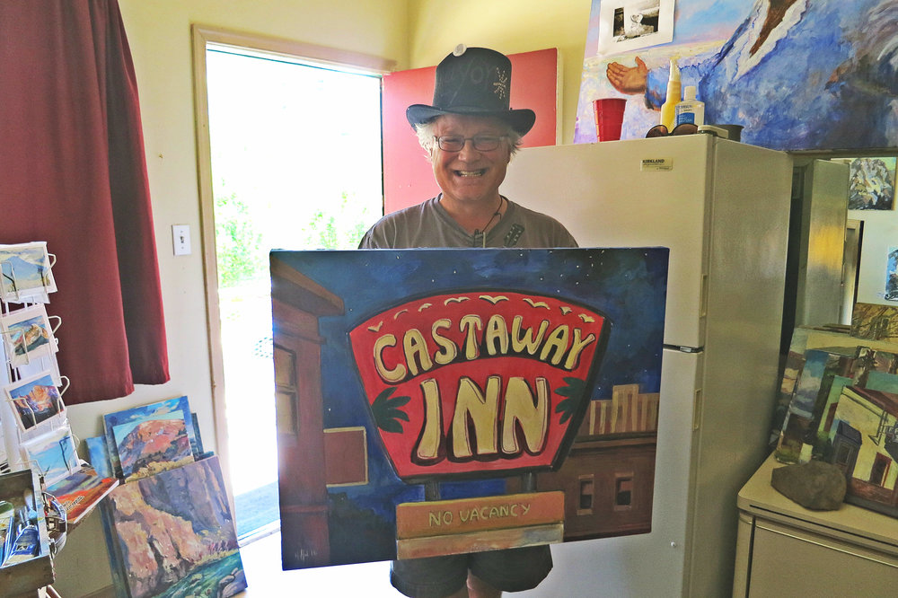 Erik Holland, with one of his works in progress, the sign of the Castaway Inn motel, which faces possible demolition as part of a huge project to redevelop downtown Reno.