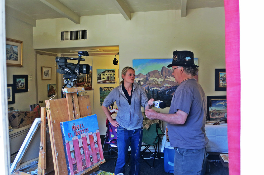 Bright Lights: Holland, being interviewed by KOLO 8 News Now on Sunday June 19, 2016, has been a constant advocate for the arts and outdoors in Reno.
