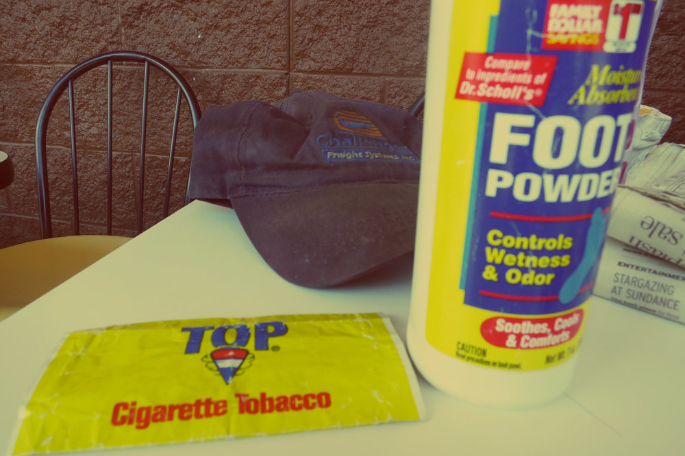 Some of the items her Dad always had with him: tobacco, foot powder, caps and newspapers he loved to read.