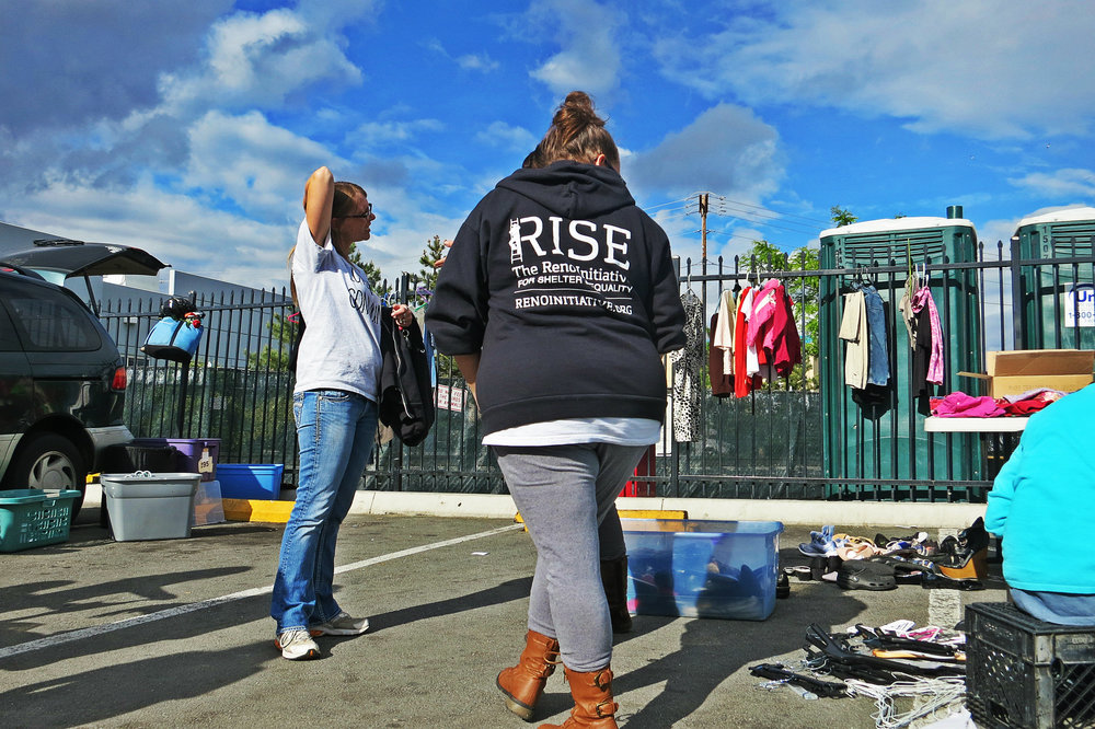 Members of RISE, holding a free market here at the homeless shelter, will be among those taking part in the week of actions against gentrification.