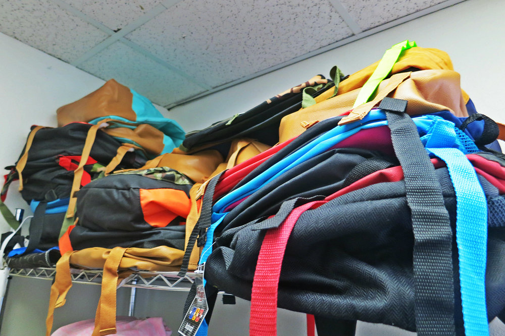 A backpack drive helps Children in Transition make sure all its students are equipped for school just like any other student.