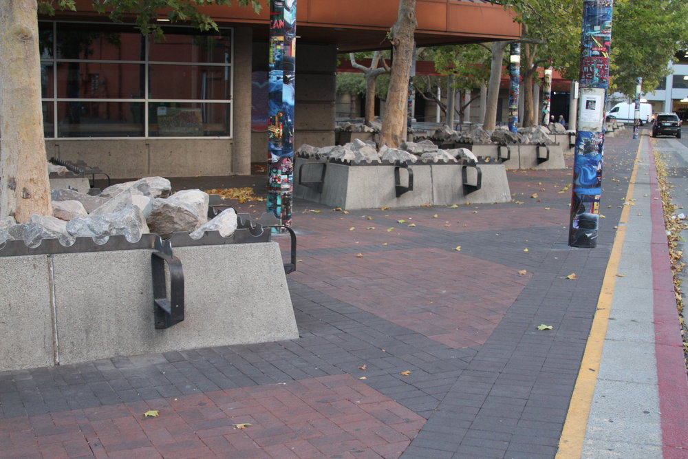 A few minutes later, and the busy spot is still totally empty. Who has a right to be downtown? Photo by Jose Olivares