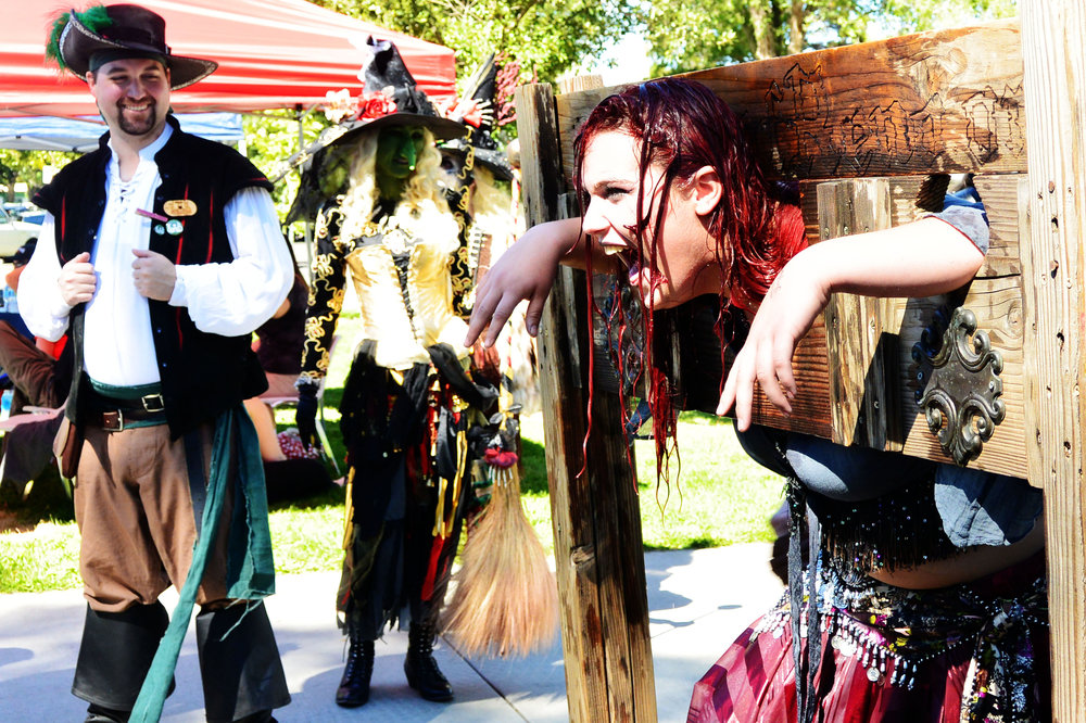 "Flogging, water torture, accepting bribes to issue warrants, drenched survivors told to ""go forth and sin some more,"" and auctions for We Care Volunteers were part of the festivities as pirates and witches invaded Idlewild Park."