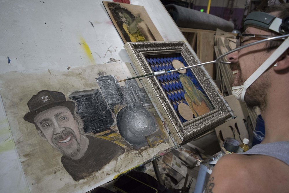 """A lot of people think people with disabilities can't do anything at all,"" says 23-year-old Creative Potential artist Connor Fogal. He has limited use of his arms and legs due to cerebral palsy."