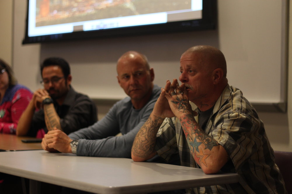 Larry (right), who lives in a weekly motel, took part in a panel on homelessness last week in Reno. Photo by Jose Olivares for Our Town Reno