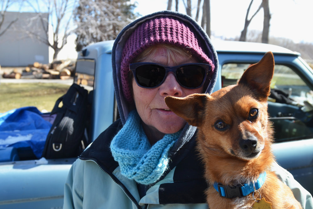 Deb lives in her truck with Filo.  She says she used to work in real estate, but fell on hard times when she had to take care of her ailing mother. She wouldn't be allowed to keep Filo with her at Reno's main shelter. Photo by Jacob Jacoby for Our Town Reno