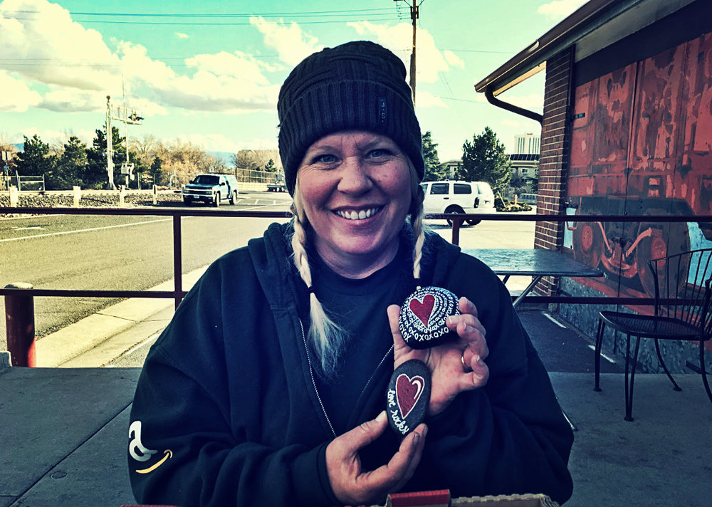 "If you have ever seen rocks painted with ornate designs hiding around Reno, you may have just seen artwork painted by Debi Handrich-Walker. Walker is a founder of a Facebook group called  Reno Painted Rocks  dedicated to painting rocks with designs and hiding them in random spots across the city. Walker started the group in December 2016 after seeing a similar Facebook group called  Whidbey Island Rocks  based in Washington. ""I think that painting or having an outlet does allow for stress relief. If I've had a rough day at work, I go in and I paint and I feel better,"" Handrich-Walker said.  Photo and Reporting by Kevin Sheridan shared with Our Town Reno."