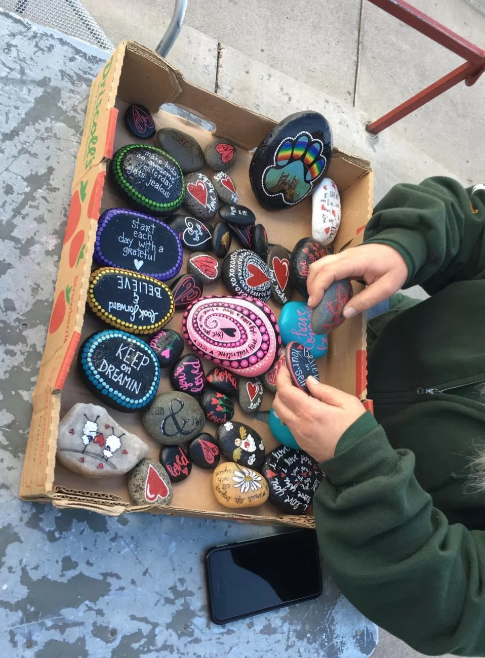 Handrich-Walker, who says she has planted hundreds of rocks around Reno since the group was founded, added that the time it takes to paint a rock depends on its size.  She said it can take anywhere from one to two hours or several minutes. Photo and reporting by Kevin Sheridan shared with Our Town Reno.