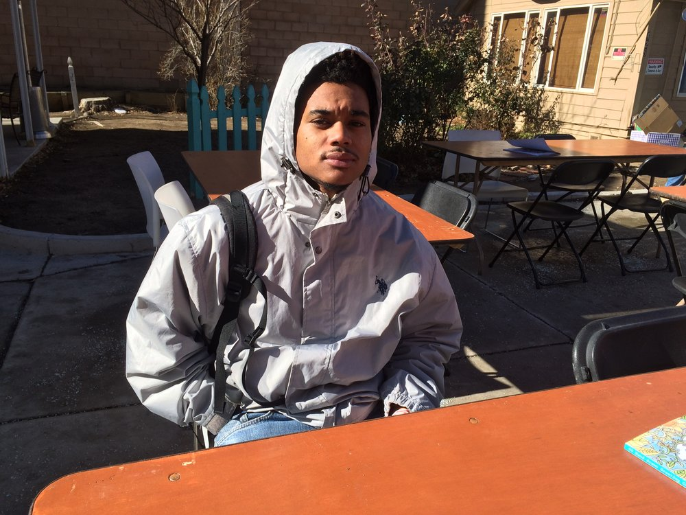 Anthony, 19, a high school dropout from Sacramento, hooked on drugs, and trying to stay away from his family, says he's been homeless for a year now in Reno. Photo and Interview by Prince Nesta for Our Town Reno