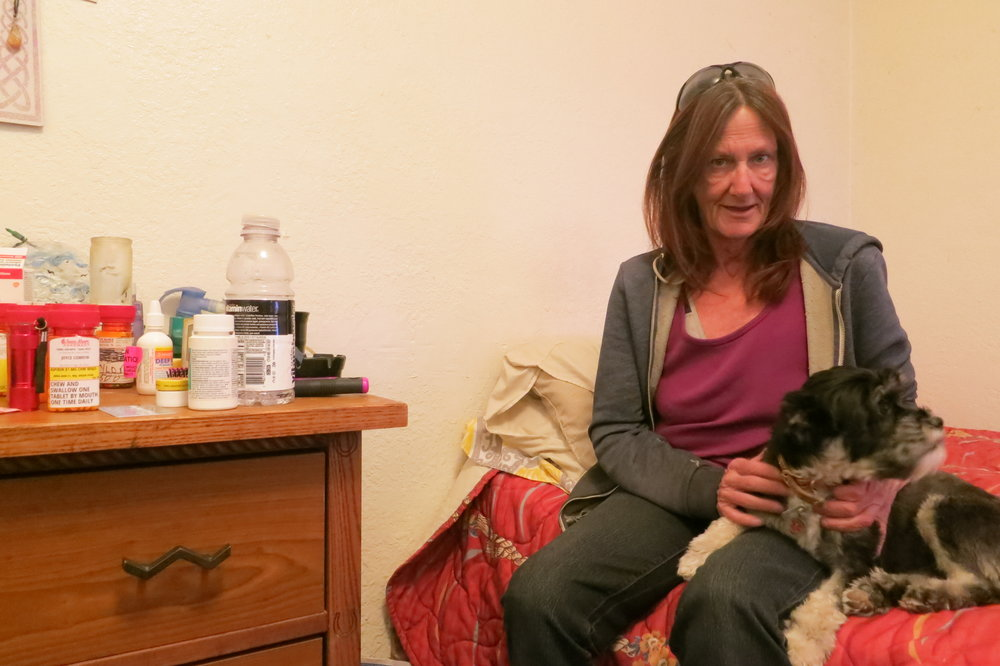 "Cowdin, who suffers from chronic obstructive pulmonary disease, with her rescue and service dog, Aurora, in her room at the El Tavern Motel.  ""I've been in this city long enough to see the changes,"" she says. ""They have these misconceptions when they tear down these motels that they're doing the city a favor. They're really not. They're just adding to the problem."""