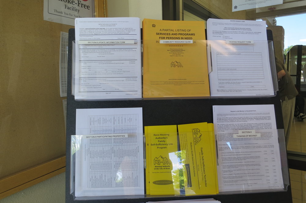Brochures and application forms on display at the entrance of the RHA offices.