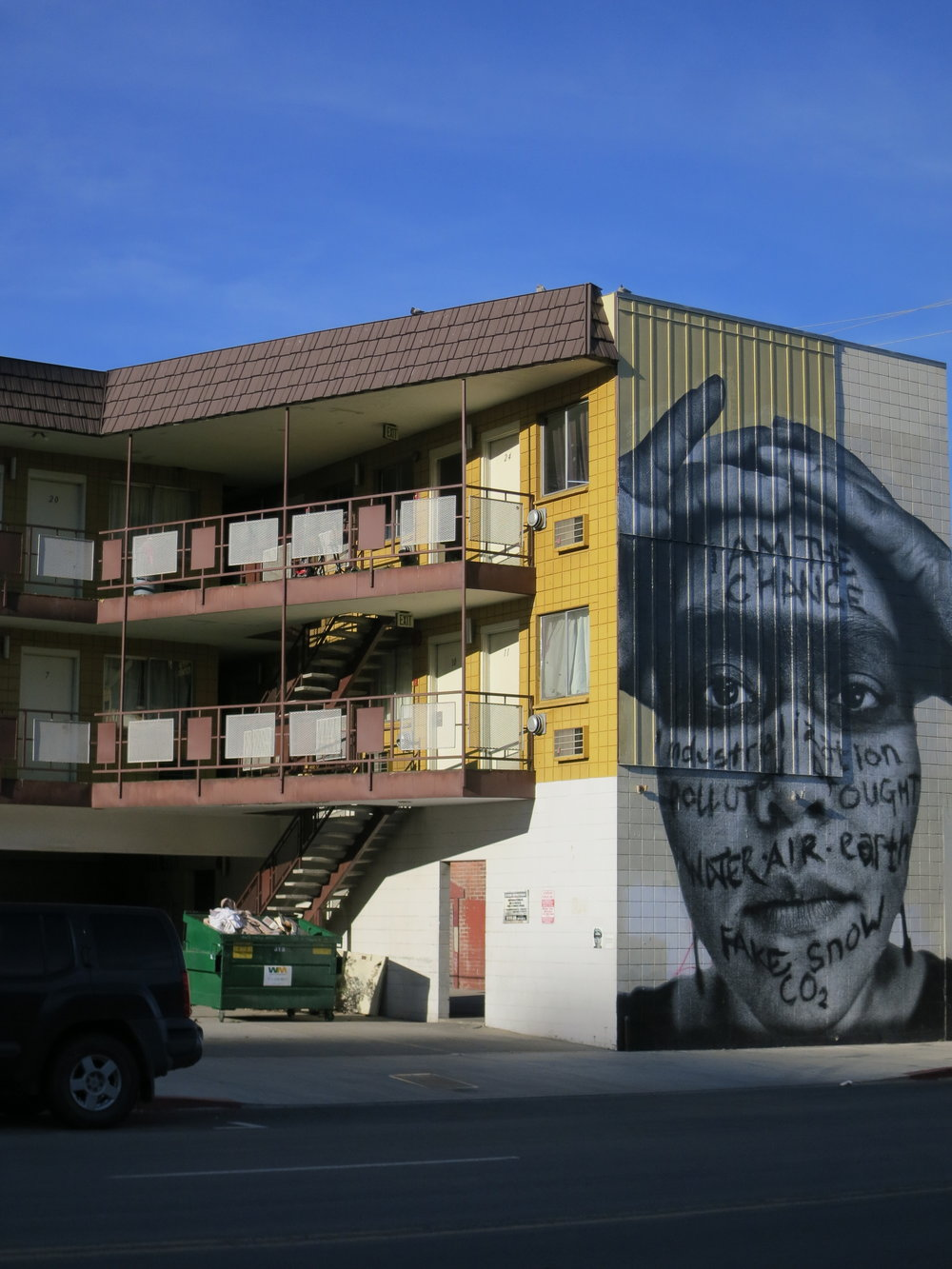 A mural recently added to the side of a motel in downtown Reno, even as many motels, often the last rung before homelessness, are being bulldozed away.