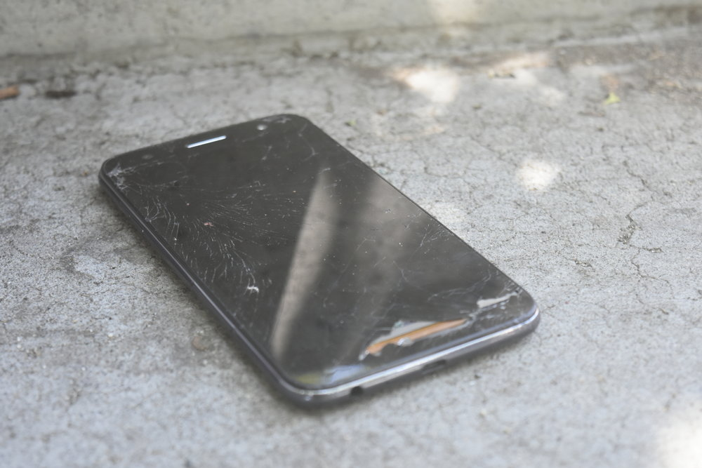 Jody says he phone was doused and damaged by someone else staying at the Prayer House, adding a new complication to her daily struggles. Photo by Jordan Blevins with reporting by Prince Nesta for Our Town Reno.