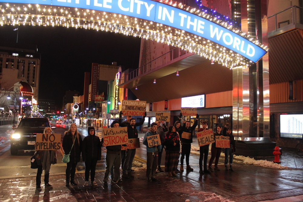 Around 5:30 on Tuesday, January 8th, a group of 15 or so supporters of the Unist'ot'en Camp met around the Believe Sign in downtown Reno. The event was coordinated and lead by Xóchítl Pāpalōtl Zapata, a local Indigenous activist who took the Unist'ot'en supporters through the current situation in Unist'ot'en Camp. Photo and reporting provided to Our Town Reno by Louis Magriel.