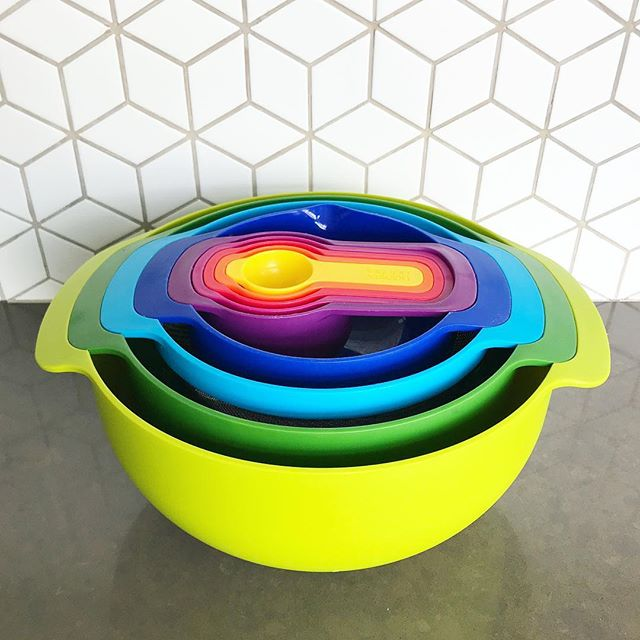 """In case you couldn't tell, I love color, and I love puns. So of course I fell in love with this """"nesting"""" bowl set from @josephjosephofficial immediately. I think I actually bought them about a year before the #tinyhouse was actually up and running. I mean, (swipe to see) look at all of those functions in that small space! We're always on the lookout for ingenious space saving solutions, so if you have any other favorite gadgets, send them our way! #smallspaceliving #kitchengadgets #smallkitchen #tinyhouseairbnb"""