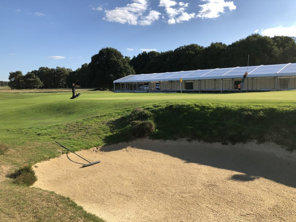 The 18th Green, with stands going up, at Walton Heath