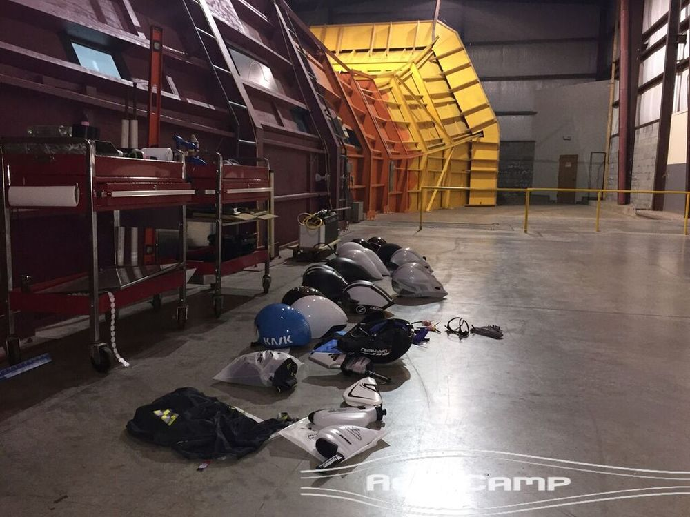 Yep, just change right here in this giant warehouse next to a pile of helmets