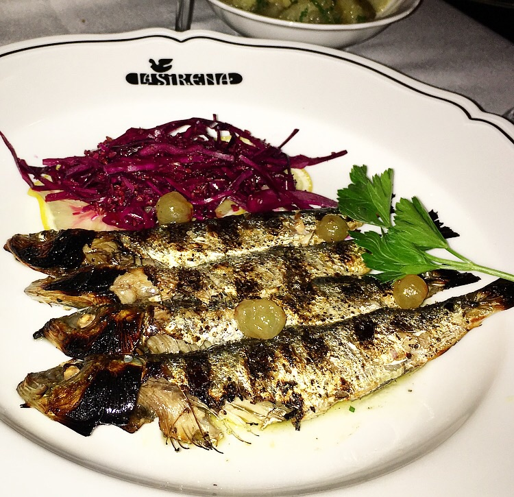 Fresh, plump, grilled sardines served with a tangy coleslaw.