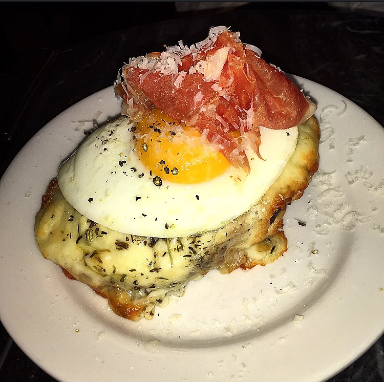 Cheesy Cr'q Madame, topped with a slice of prosciutto, some grated parmesan and a couple pieces of deliciously pungent fried sage hidden underneath the egg.