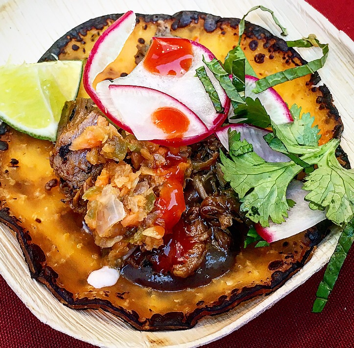 Marc Forgione 's lamb barbacoa, guajillo and black garlic tortilla