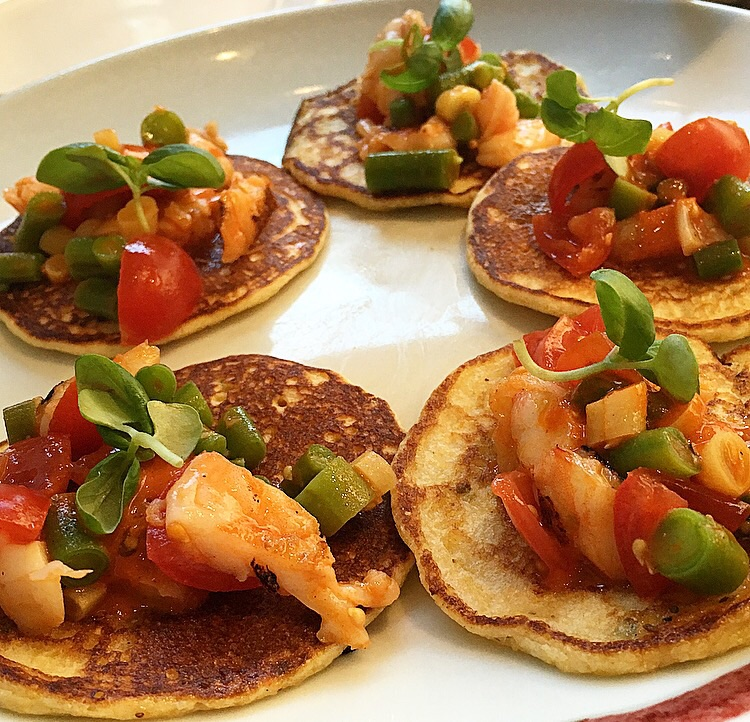 Corn pancakes topped with grilled shrimp, green beans and tomato.  Yummy!