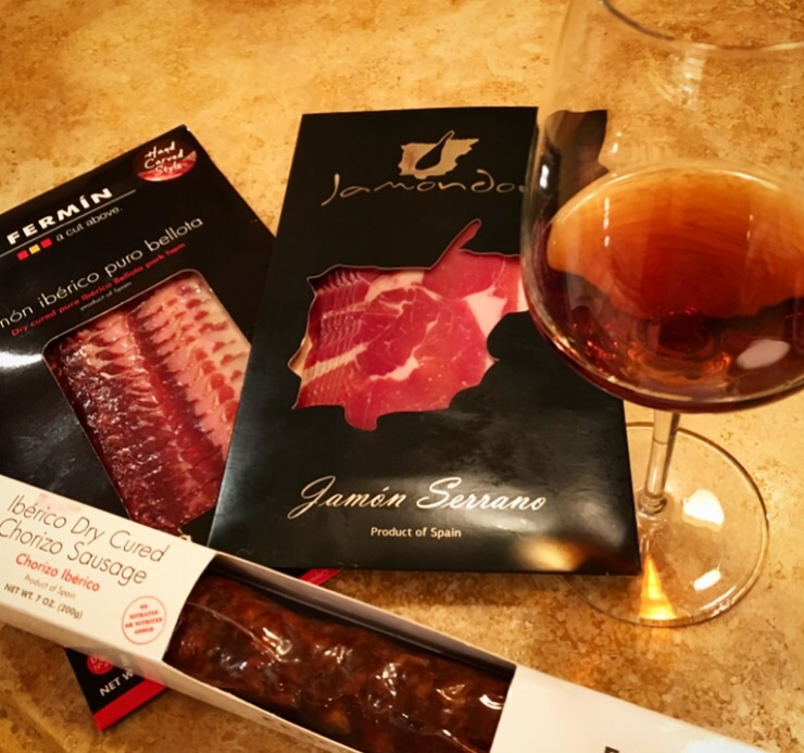 Getting ready to have some cured meats with an Oloroso Sherry. the dark color of the wine comes from oxidative aging in barrels.