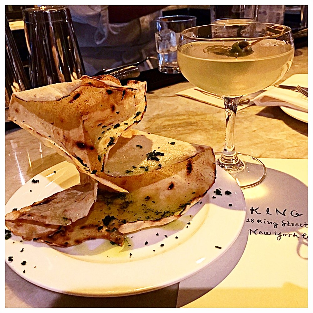 "This Sardenian style crispy cracker with olive oil and herbs  is known as a ""Carta de Musica"" (music paper bread).  It was a great start to the meal accompanied by theA++ dirty martini.."