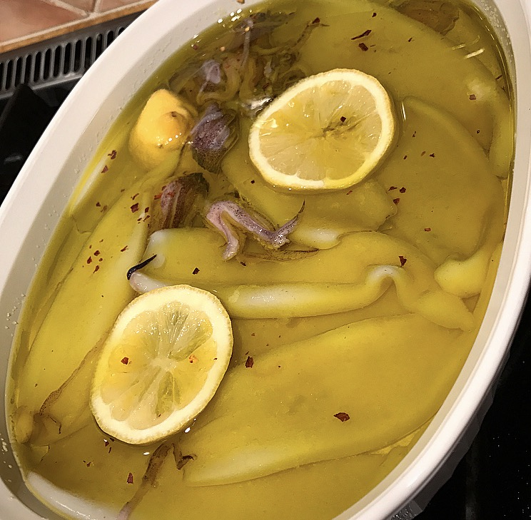 Squid with olive oil and lemon ready for the oven.