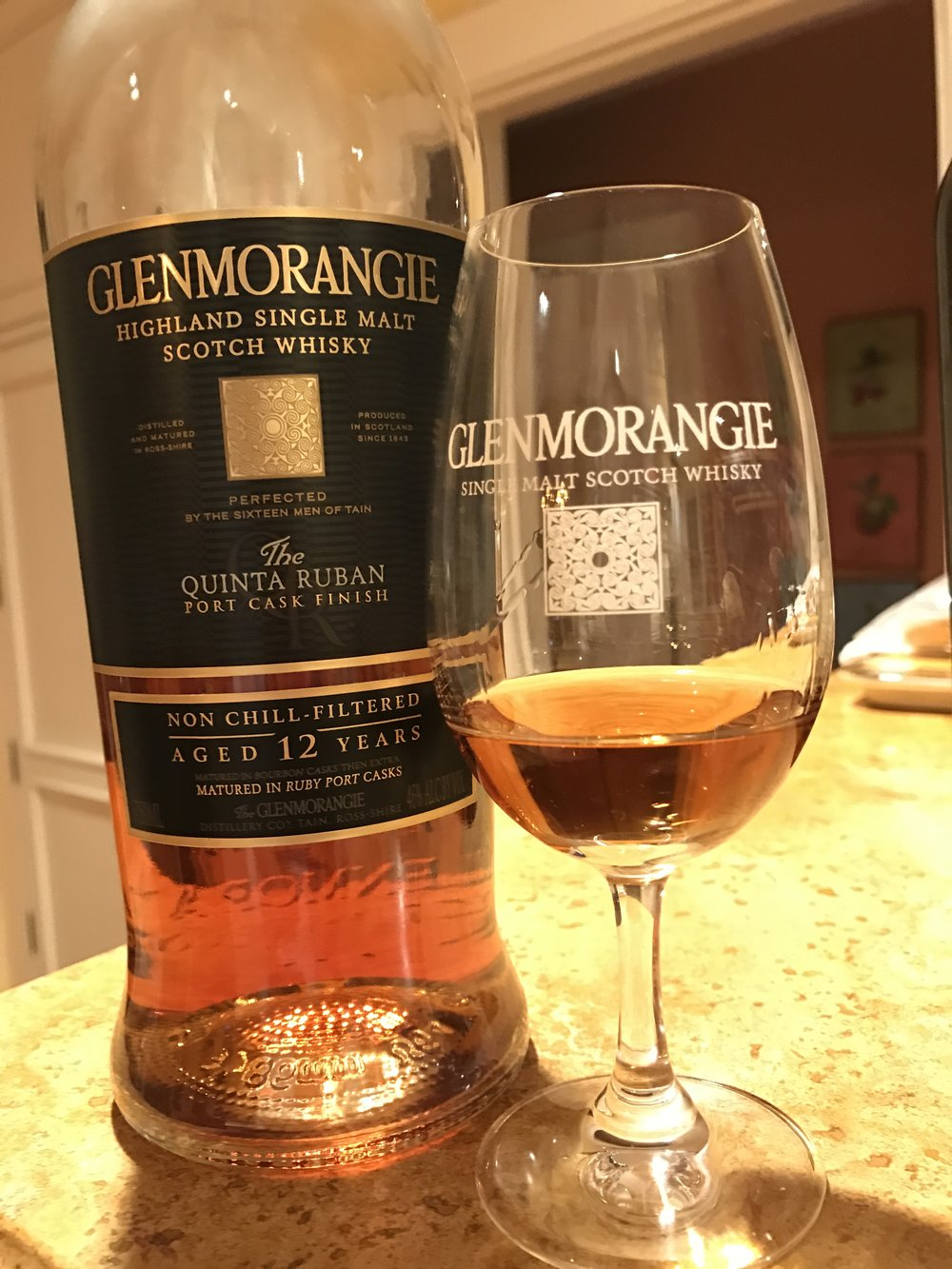The Glenmorangie Quinta Ruban Scotch whisky picks up its beautiful caramel color from being extra-matured in Port barrels.