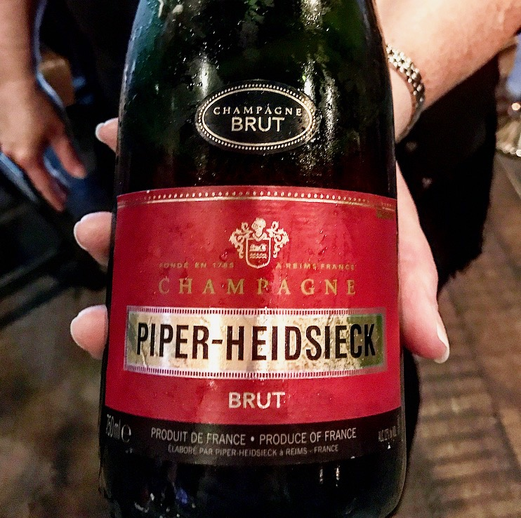 The Piper-Heidsieck Cuvee Brut found at your local wine shop will have this red label and should cost about $36