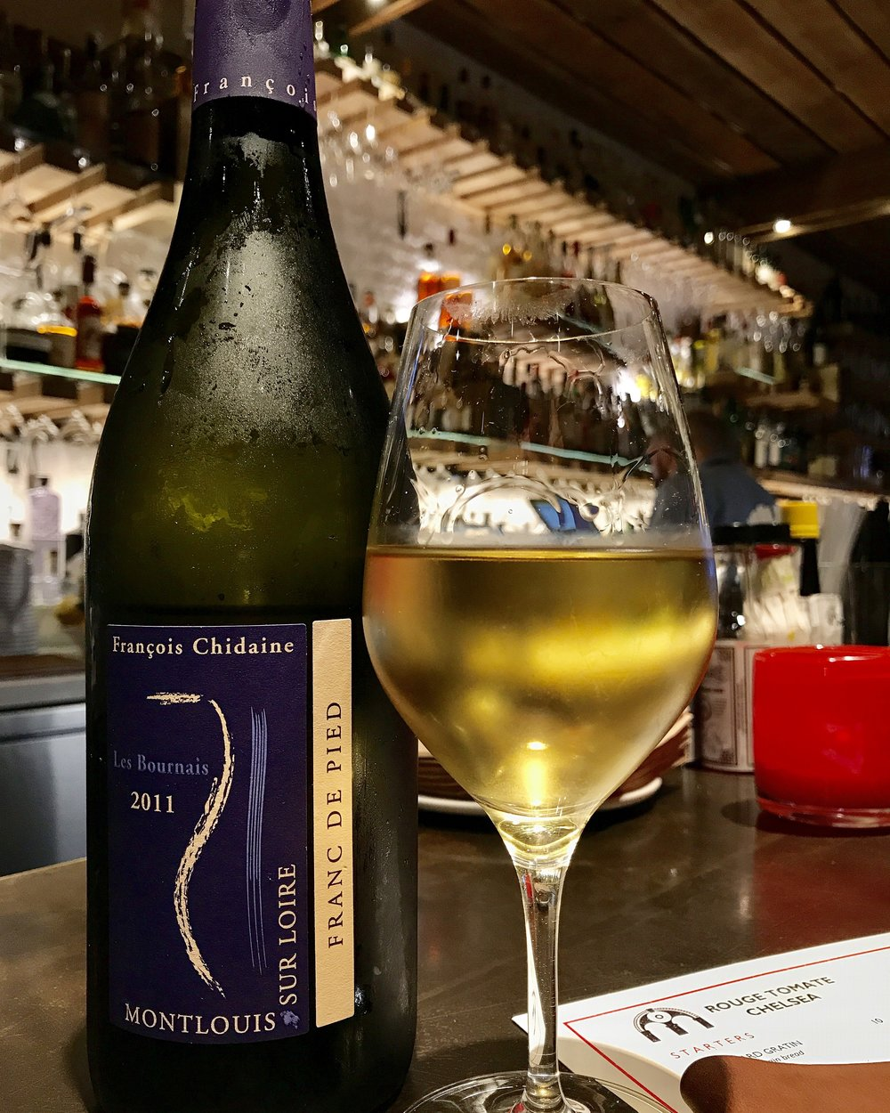 Happiness is Sitting at the bar, sipping this Francois Chidaine Chenin Blanc from the Loire Valley