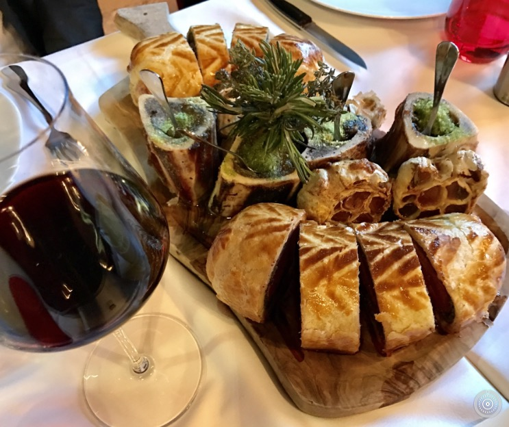 The Beef Wellington is a house specialty at Le Bordeaux Gordon Ramsay.  Here, with bone marrow, roasted garlic and a glass of red Bordeaux wine, it was divine!