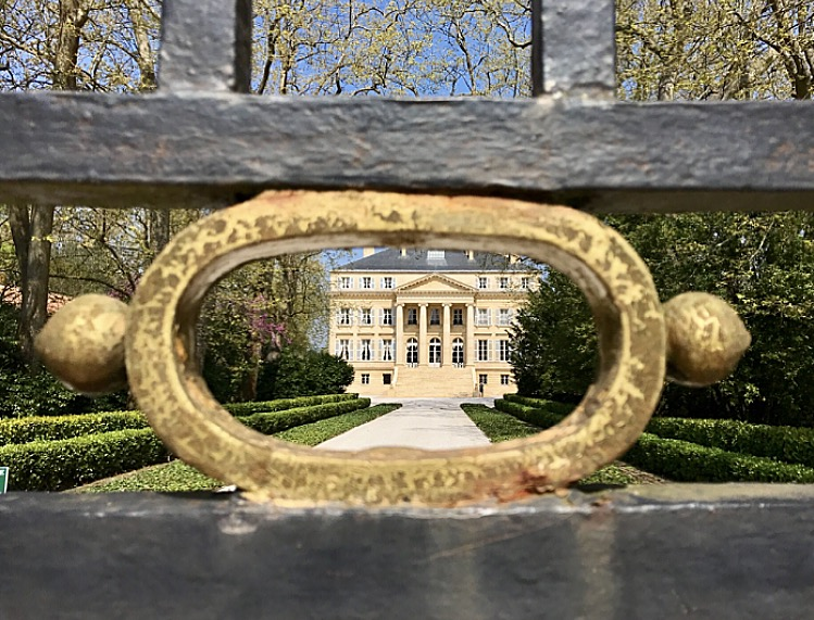 Looking through the wrought iron gates to the magnificent Château Margaux.