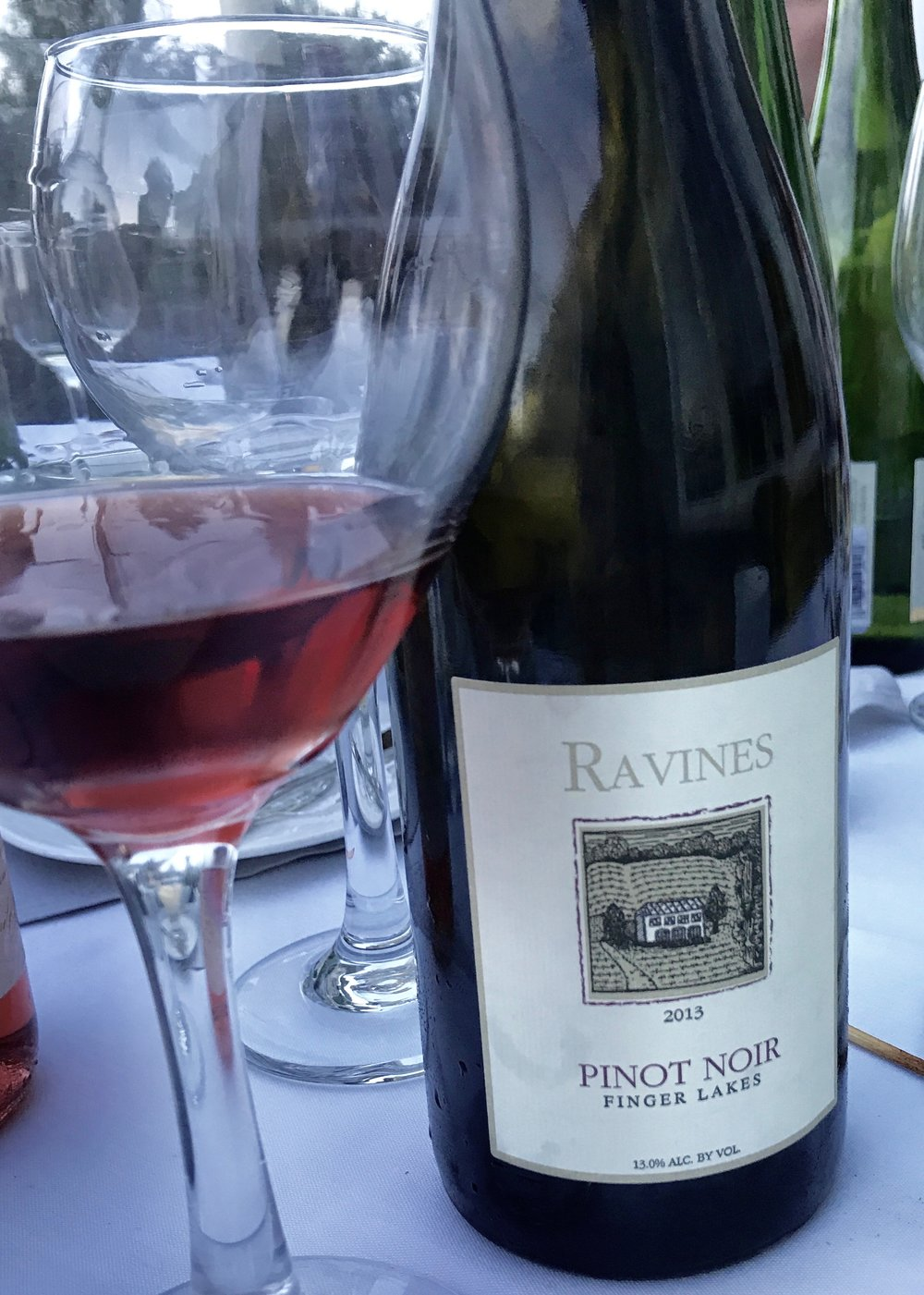 At dinner in the Finger Lakes enjoying the 2013 Ravines Pinot Noir.   Notice the gorgeous light red color.  Click  here  to find out where to buy it near you.
