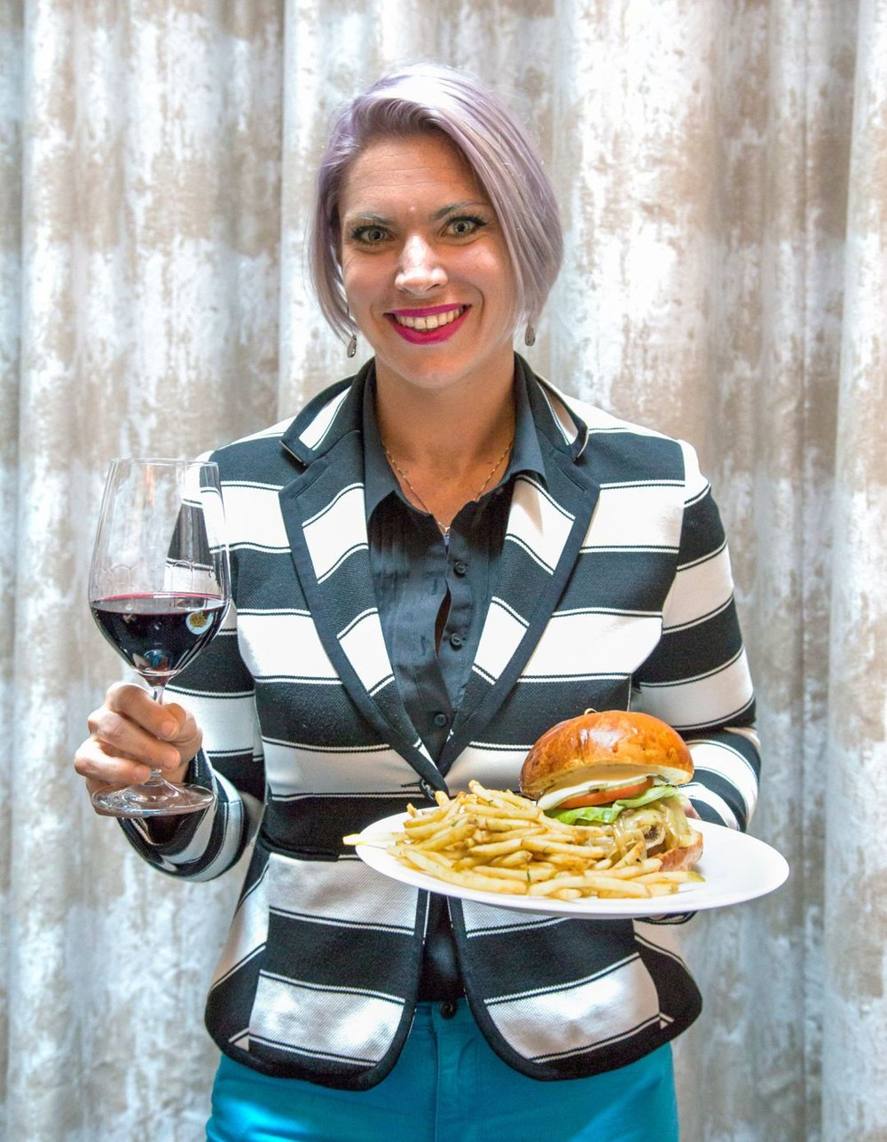 "Amanda Streibel, Lead Sommelier at Charlie Palmer Steak, paired the Famous 50-50 Burger (the patty is made with half bacon and half beef and topped with caramelized onion jam!) with a complex Napa Valley Cabernet Sauvignon.  Amanda says that ""The caramelized onion jam adds a sweet touch which complements the ripe fruit quality in the wine, which has enough oak to stand up to the heavy burger."""