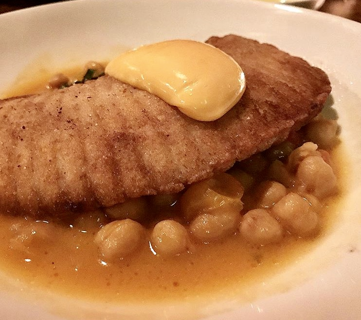 Skate with chick peas and garlic aioli in a saffron broth at The Milling Room.