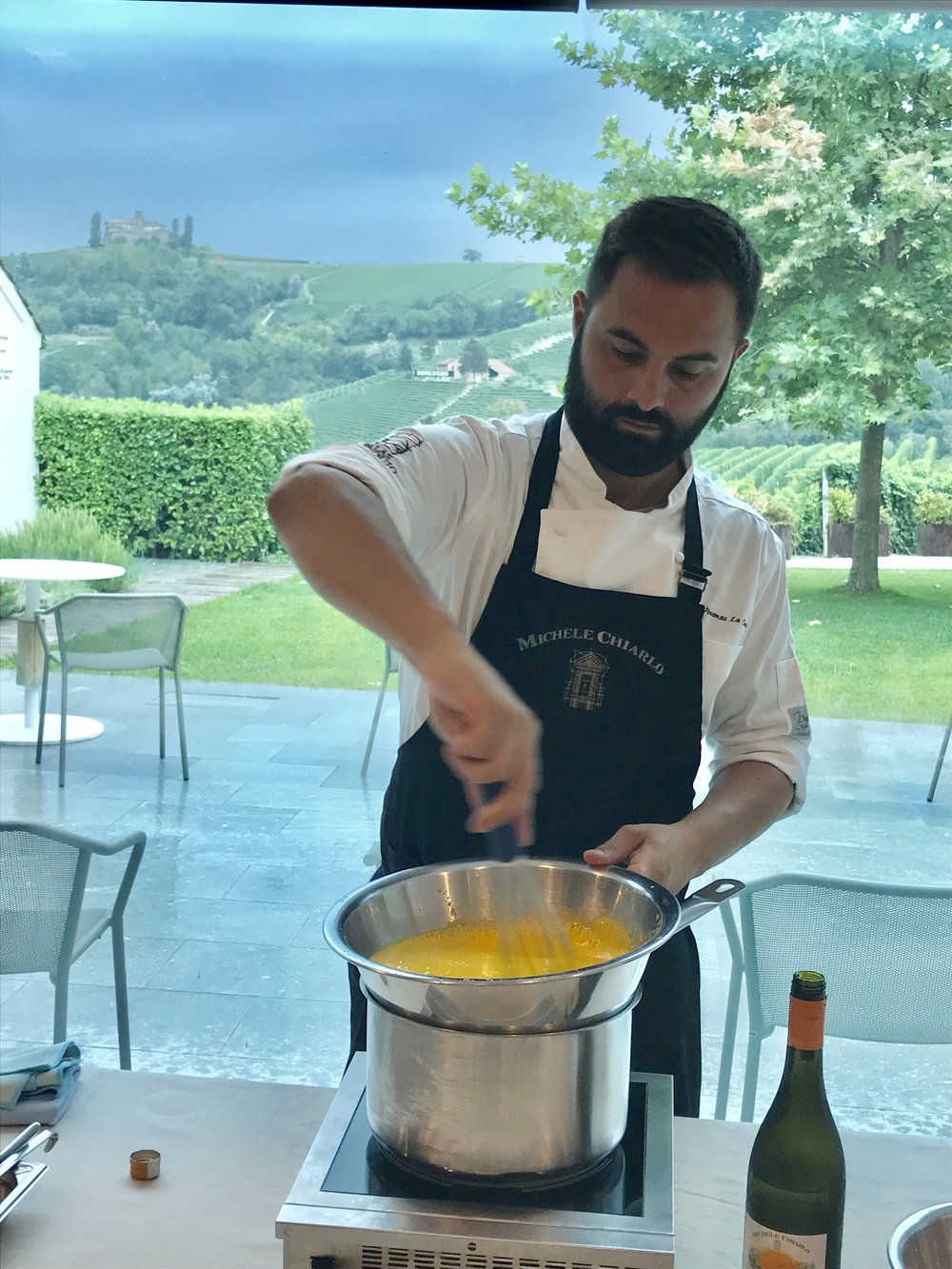 Chef making a perfect zabaglione. Notice the spectacular views in the background.