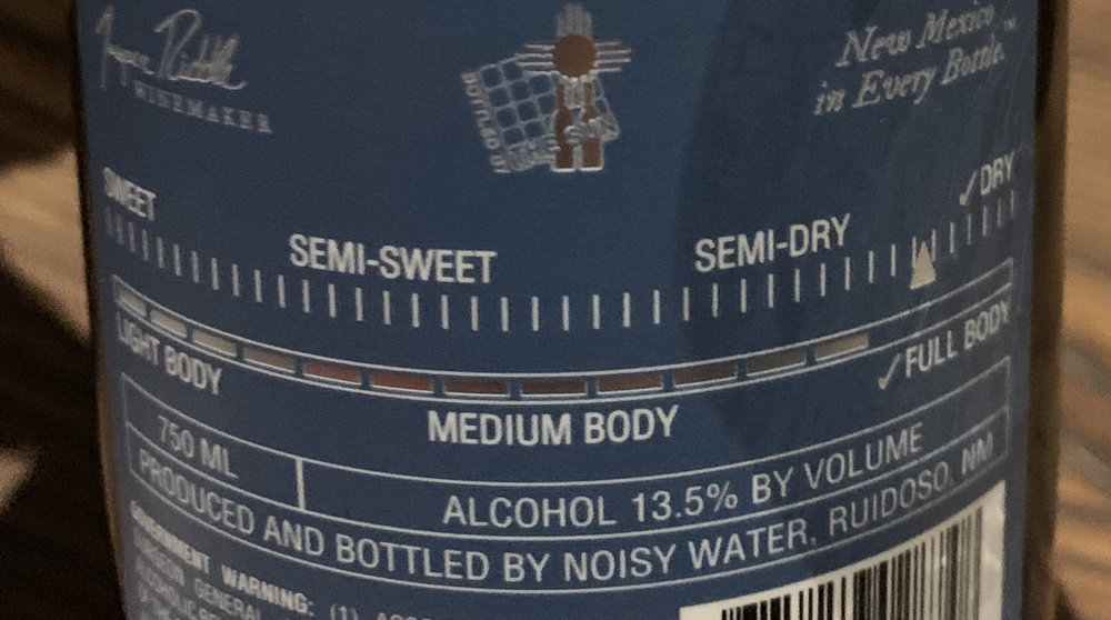 The back labels of Noisy Water Winery let you know how sweet or dry the wine is.