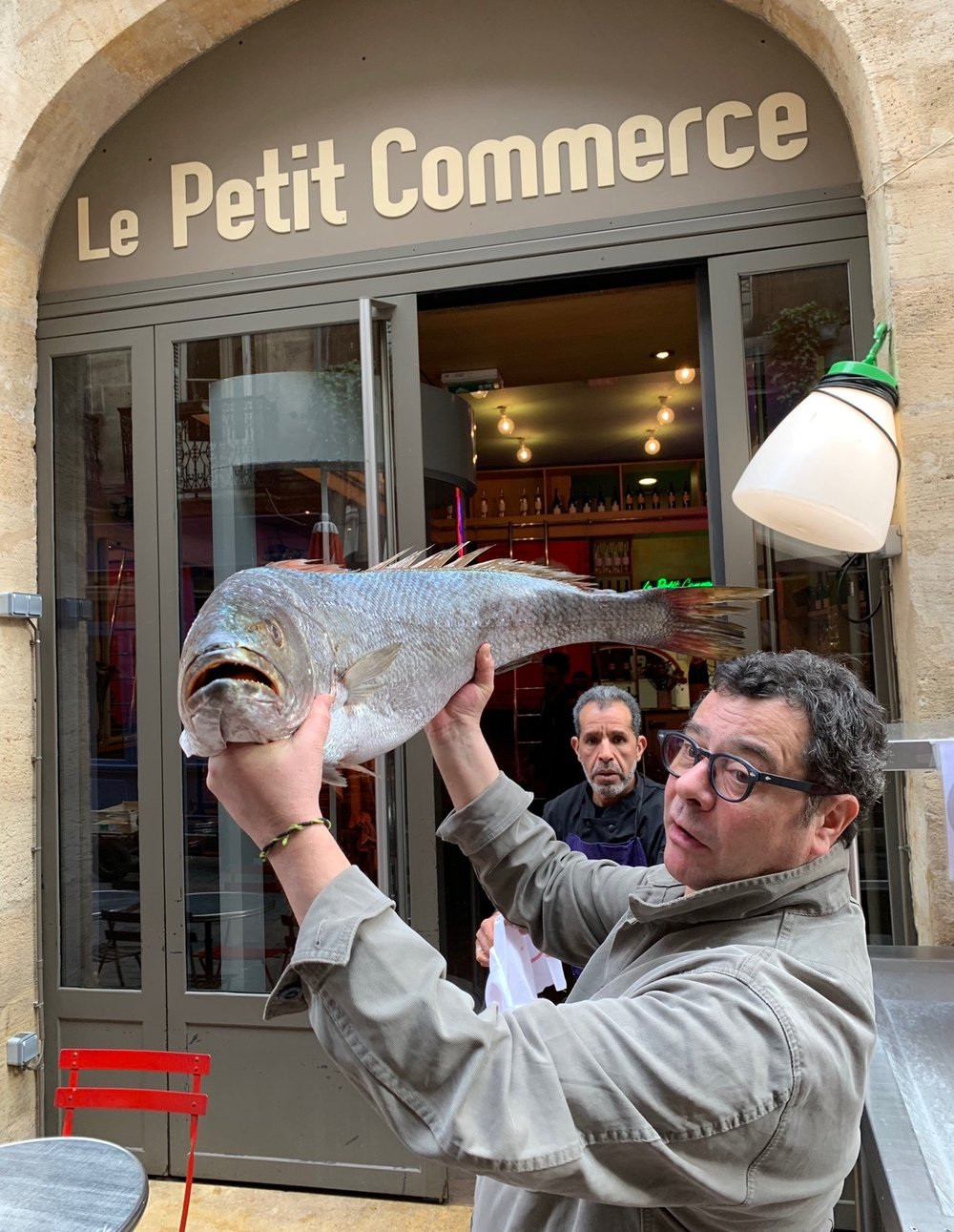 Outside Le Petit Commerce with the owner and his fresh catch of the day!