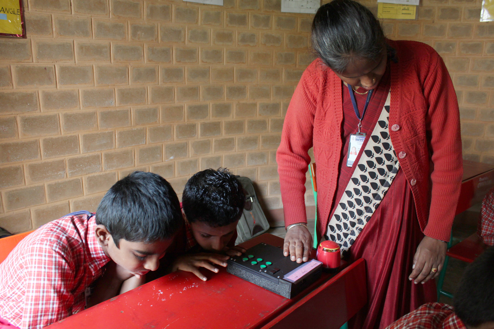 Observing a classroom use the Stand-Alone Braille Tutor during a class. The teacher pictured above is also blind, but an incredibly strong-willed and commanding teacher.