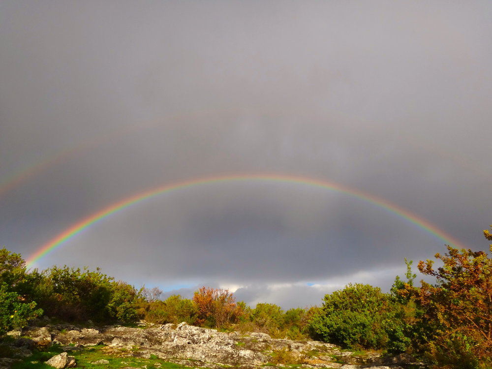 It was quite extraordinary to hear the thunderstorm outside while we were in the cave. By the time we got out, the dark sky welcomed us with two complete rainbows!