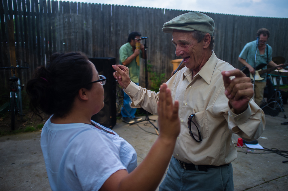 Francisco, a blind resident from Cuba, dances at  convivio  with a volunteer.