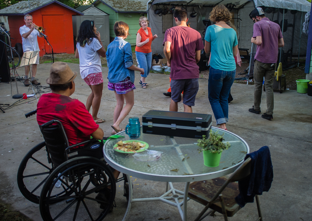 Residents and volunteers dance together at  convivio .