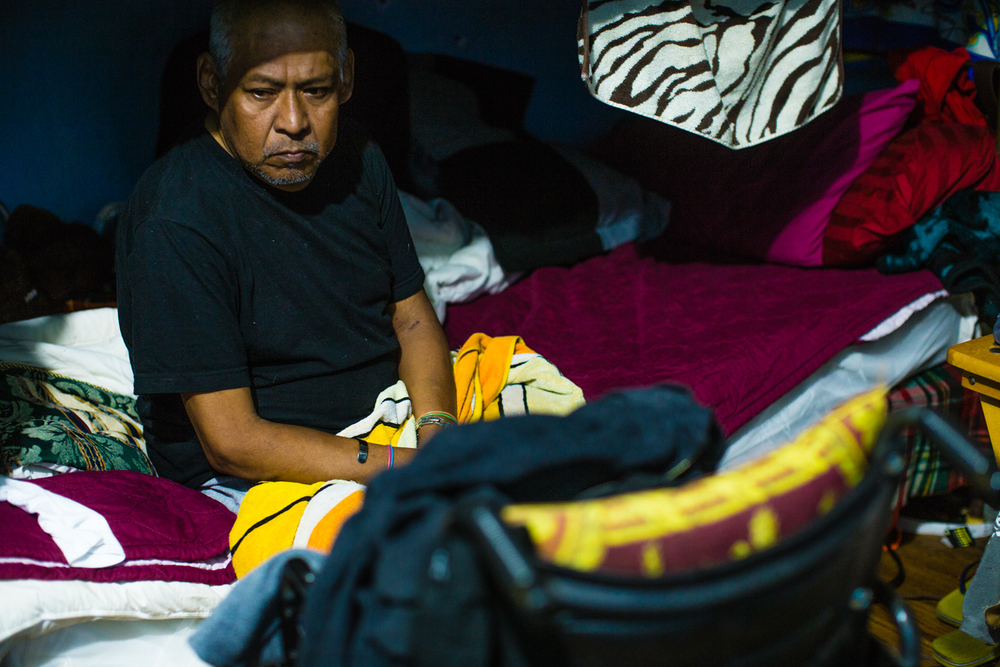 Teo, a terminally ill resident waits for curfew.