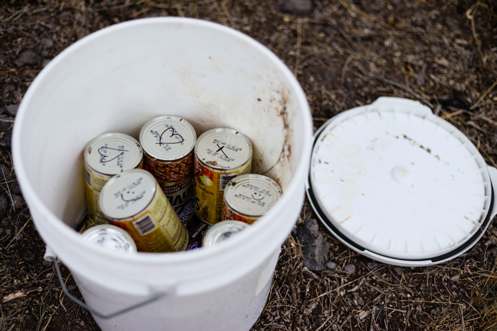 In addition to water, non-perishable food such as beans, are placed in covered buckets.