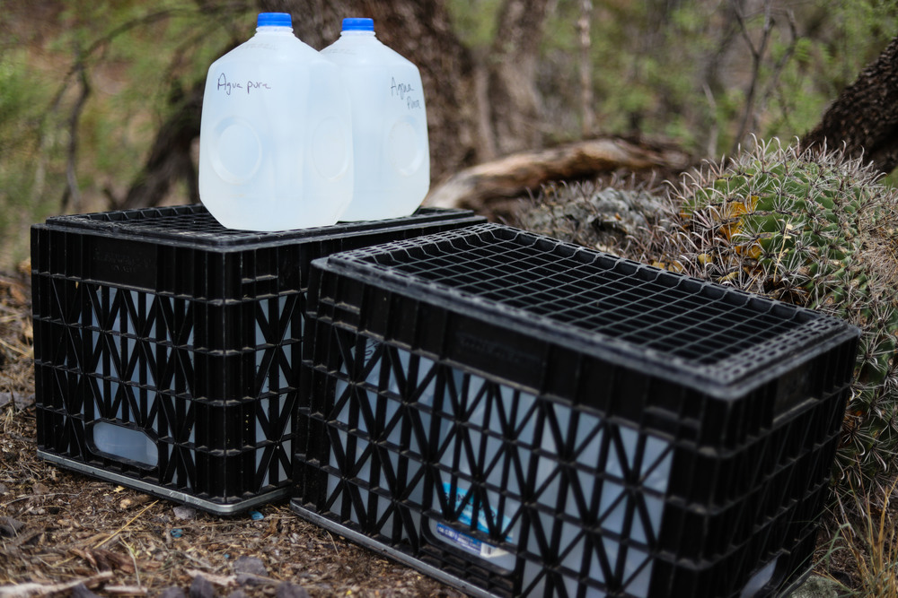Crates protect the water from animals and the elements.